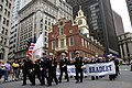 US Navy 071007-N-8110K-003 Crew members of the guided-missile frigate USS Bradley (FFG 49) pass the Old State House in downtown Boston during the annual Columbus Day Parade.jpg