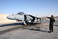 US Navy 071117-M-7404B-017 U.S. Marine Pfc. Craig A. Phelps, a plane captain assigned to Marine Attack Squadron (VMA) 542, communicates with a pilot of an AV-8B Harrier while preparing for a mission.jpg
