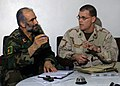 US Navy 080130-N-7415V-002 Cmdr. James Haley, commanding officer of Navy Embedded Training Team 3-205th Garrison, meets with Col. Shir Ahmmad Samadi, the commander of the Afghan National Army Shorbak garrison.jpg