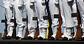US Navy 080612-N-0640K-212 Sailors assigned to the honor guard aboard the Nimitz-class aircraft carrier USS Ronald Reagan (CVN 76) stand in formation during a burial-at-sea ceremony.jpg