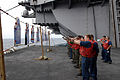 US Navy 080824-N-4005H-252 Sailors aboard the Nimitz-class aircraft carrier USS Ronald Reagan (CVN 76) fire 9 mm pistols at targets during a small-arms weapons qualifying exercise on aircraft elevator 4.jpg