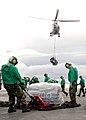 US Navy 080917-N-7282P-057 Sailors move cargo on the flight deck of the aircraft carrier USS George Washington (CVN 73).jpg