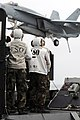 US Navy 090319-N-3610L-615 Sailors watch as an F-A-18E strike fighter makes an arrested landing.jpg