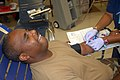 US Navy 090804-N-9564W-035 Yeoman 1st Class Timothy Gilbert, assigned to Headquarters Company of Naval Mobile Construction Battalion (NMCB 74), donates blood during a blood drive.jpg