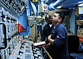 US Navy 100425-N-9301W-095 Gas Turbine System Technician (Mechanical) 2nd Class Louie Reyes, front, and Gas Turbine System Technician (Electrical) 2nd Class Christian Djiofack conduct an emergency seawater cooling valve test.jpg