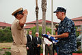 US Navy 100430-N-4913K-005 Logistics Specialist 3rd Class Michael Gibbs hands the national ensign to Chief Boatswain's Mate Darryl Thomas, Naval Station Ingleside command career counselor, after it was flown for the last time a.jpg