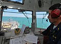 US Navy 100505-N-6138K-019 Ensign John Thomson directs an Spanish navy AB-212 helicopter.jpg