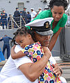 US Navy 100709-N-0464S-010 Command Master Chief John Hall says his goodbyes to his family before departing for a seven-month deployment.jpg