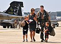 US Navy 100907-N-9565D-137 Cdr. Michael Esper leaves the flight line with his wife and children during a homecoming celebration at Joint Base Andre.jpg