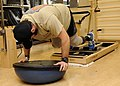 US Navy 110309-N-UB993-129 A Sailor mountain climbers using the core align pilates machine during a physical therapy appointment in the Comprehensi.jpg