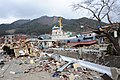 US Navy 110315-N-2653B-148 A tug boat is among debris in Ofunato, Japan, following a 9.0 magnitude earthquake and subsequent tsunami.jpg