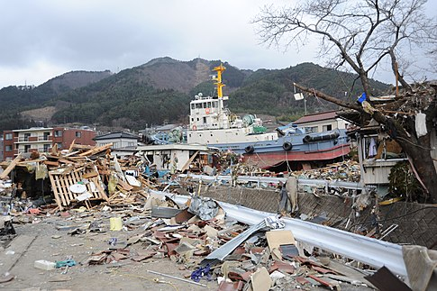 A tug boat among the debris in Ofunato.