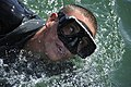 US Navy 110405-N-KK330-284 A Basic Crewman Training candidate takes a breath during a conditioning swim in San Diego Bay.jpg