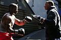 US Navy 110414-N-RC734-486 Lance Cpl. Michael Anderson, left, and Logistics Specialist 3rd Class Corey Rainey practice boxing as part of their phys.jpg