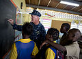 US Navy 110419-N-RM525-227 Capt. Michael Jacobsen, U.S. 4th Fleet chief of staff, plays math games with school children during a Continuing Promise.jpg
