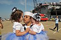 US Navy 110516-N-QY430-218 Mass Communication Specialist Seaman Jonathan Vargas holds his daughters during a homecoming celebration for the amphibi.jpg