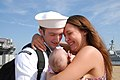 US Navy 110516-N-VK779-090 Machinist's Mate Fireman Roberto Valentine holds his daughter for the first time during a homecoming celebration for the.jpg