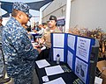 US Navy 110928-N-YQ852-015 Aviation Structural Mechanic 1st Class Bryan Menchen, a San Diego Recruiter, speaks to Sailors about the benefits of joi.jpg