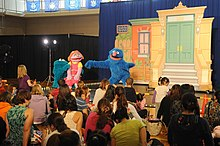 US Navy 111013-N-TO330-241 Naval Air Facility Atsugi residents watch as Sesame Street characters Grover, Katie, and Cookie Monster sing and dance d.jpg