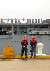 US Navy 111221-N-JP983-006 Sailors assigned to the amphibious dock landing ship USS Oak Hill (LSD 51) man the rails as the ship returns to homeport.jpg