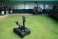 US Navy 120125-N-MT220-046 A Sailor shows an elementary school student class how to maneuver a Talon robot.jpg