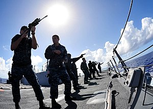 US Navy 120210-N-ED900-831 Sailors aboard the guided-missile destroyer USS Pinckney (DDG 91) receive dry fire and weapon movement training with the.jpg