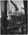 United Kingdom. Clydebank, Scotland. Still a shapless frame work of steel scaffolding, this 28,000 ton oil tanker... - NARA - 541770.tif