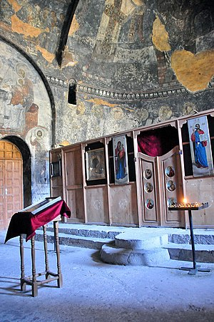 Vardzia - View to the apse and iconostasis or screen decorated with icons that separates the nave from the sanctuary