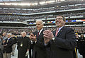 Vice President Joseph Biden, left, and Deputy Secretary of Defense Ashton B. Carter applaud after the National Anthem is played before the start of the Army vs 121208-D-NI589-075.jpg