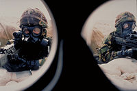 View Through Face Mask of Two Soldiers Wearing Protective Chemical Weapons Clothing MOD 45101880.jpg
