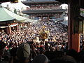 View of mikoshi from sensoji Sanja Matsuri 2006.JPG