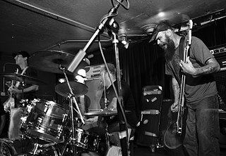 """Weedeater (band) A stoner/sludge metal band formed by Dave """"Dixie"""" Collins formerly of Buzzov*en."""
