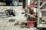 Well drillers clean equipment 150807-F-LP903-0565.jpg