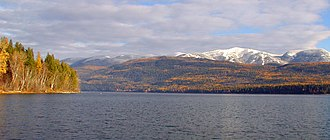 Whitefish Lake (Montana) - View from Whitefish Lake State Park beach looking north to Whitefish Mountain Resort in autumn, courtesy Mike Koopal