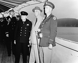 Winston Churchill with Franklin D. Roosevelt on board USS Augusta (CA-31) on 9 August 1941 (NH 67201)