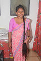Woman with very long black braid Sri Lanka.jpg
