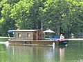 Wooden boat on Yonne River in Villeneuve.jpg