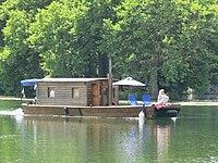 Wooden boat on Yonne River in Villeneuve.jpg