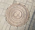 Yerevan - Manhole cover with grape, National Assembly Park (2018).jpg