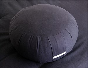 A zafu, the traditional seat cushion used in z...