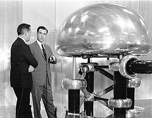 Albert Crewe - Crewe (right, facing camera) explains the ZGS's Cockroft-Walton preaccelerator.