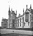 """Modern Gothic church or institutional - ecclesiastical building much battlemented, turretted"" is Magee College (36148036241).jpg"
