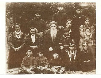 "Krymchaks - Rabbi Chaim Chizkiyahu Medini,  the ""chacham"" of the Krymchaki Jews,   with his wife, daughters, sons-in-law, and grandchildren.  Taken shortly before he left to Eretz Yisroel."