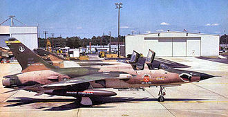 128th Airborne Command and Control Squadron - 25 May 1983 at Dobbins AFB. Republic F-105F-1-RE Thunderchief 63-8299 heading to the boneyard, the last F-105 in USAF service. Next to it is McDonnell F-4D-26-MC Phantom 65-0604, arriving for service with the 128th Tactical Fighter Squadron.