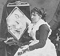 1877 Caroline S. Brooks and her sculpture in butter during a public exhibition at Amory Hall in 1877, from Robert N. Dennis collection of stereoscopic views.jpg