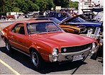 1969 AMC AMX red with tan interior at Cecil MD dragstrip show.jpg