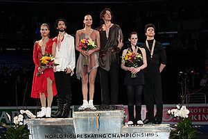 2009 World Figure Skating Championships - The ice dancing podium. From left: Tanith Belbin / Benjamin Agosto (2nd), Oksana Domnina / Maxim Shabalin (1st), Tessa Virtue / Scott Moir (3rd).