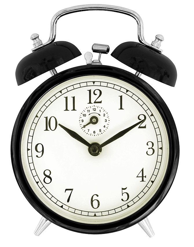 English: The face of a black windup alarm clock