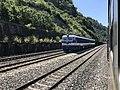 201908 SS3B-5008 hauls Freight Train at Shimenkan Station.jpg