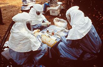2014 Democratic Republic of the Congo Ebola virus outbreak - Image: 6136 PHIL scientists PPE Ebola outbreak 1995